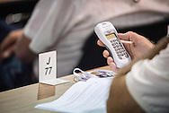 Delegate Russell Tieken works with the electronic voting system during the 66th Regular Convention of The Lutheran Church–Missouri Synod on Sunday, July 9, 2016, at the Wisconsin Center in Milwaukee. LCMS/Frank Kohn