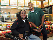 Eric LeGrand, left, SUBWAY Famous Fan and former Rutgers football player, and Anthony Barr, 2014 draft prospect, celebrate Barr's induction as the newest Famous Fan, Wednesday, May 7, 2014, in New York. Barr joins a roster of fellow Famous Fans that include Robert Griffin III, Justin Tuck, Russell Westbrook, Pele and Michael Phelps. (Photo by Diane Bondareff/Invision for SUBWAY/AP Images)