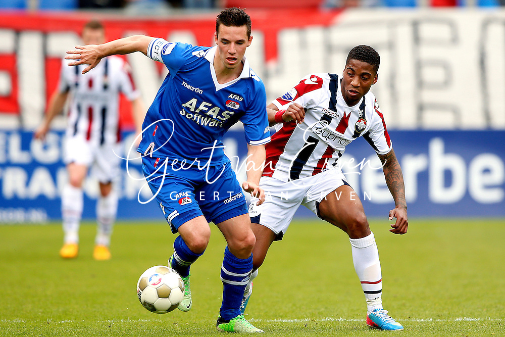 Onderwerp/Subject: Willem II - AZ Alkmaar - Eredivisie<br /> Reklame:  <br /> Club/Team/Country: <br /> Seizoen/Season: 2012/2013<br /> FOTO/PHOTO: Genaro SNIJDERS (R) of Willem II in duel with Nick VIERGEVER (L) of AZ Alkmaar. (Photo by PICS UNITED)<br /> <br /> Trefwoorden/Keywords: <br /> #04 $94 &plusmn;1355244121349<br /> Photo- &amp; Copyrights &copy; PICS UNITED <br /> P.O. Box 7164 - 5605 BE  EINDHOVEN (THE NETHERLANDS) <br /> Phone +31 (0)40 296 28 00 <br /> Fax +31 (0) 40 248 47 43 <br /> http://www.pics-united.com <br /> e-mail : sales@pics-united.com (If you would like to raise any issues regarding any aspects of products / service of PICS UNITED) or <br /> e-mail : sales@pics-united.com   <br /> <br /> ATTENTIE: <br /> Publicatie ook bij aanbieding door derden is slechts toegestaan na verkregen toestemming van Pics United. <br /> VOLLEDIGE NAAMSVERMELDING IS VERPLICHT! (&copy; PICS UNITED/Naam Fotograaf, zie veld 4 van de bestandsinfo 'credits') <br /> ATTENTION:  <br /> &copy; Pics United. Reproduction/publication of this photo by any parties is only permitted after authorisation is sought and obtained from  PICS UNITED- THE NETHERLANDS