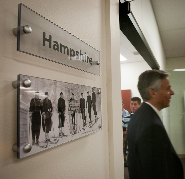 Former Ambassador to China and former Utah Gov. Jon Huntsman leaves a board room as he tours Cirtronics, an employee owned electronic contract assembly company, Milford, NH. 2nd of August 2011.