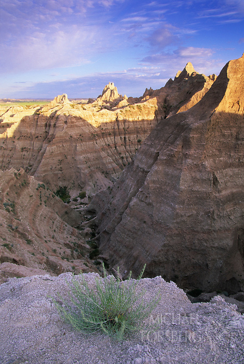 Badlands National Park, South Dakota..Morning light begins to hit the ridge tops of the badlands