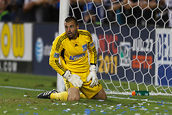 July 20, 2011; Santa Clara, CA, USA;  San Jose Earthquakes goalkeeper Jon Busch (18) kneels on the ground in front of his goal against the Vancouver Whitecaps during the second half at Buck Shaw Stadium. San Jose tied Vancouver 2-2.