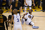 Golden State Warriors forward Kevin Durant (35) falls to the ground after a foul during Game 2 of the NBA Finals against the Cleveland Cavaliers at Oracle Arena in Oakland, Calif., on June 4, 2017. (Stan Olszewski/Special to S.F. Examiner)