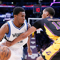 10 April 2014: Minnesota Timberwolves forward Andrew Wiggins (22) drives past Los Angeles Lakers forward Wesley Johnson (11) during the Los Angeles Lakers 106-98 victory over the Minnesota Timberwolves, at the Staples Center, Los Angeles, California, USA.