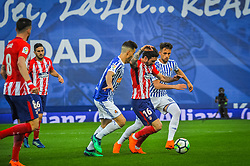 April 19, 2018 - San Sebastian, Spain - Sime Vrsaljko of Atletico Madrid duels for the ball with Sergio Canales and Adnan Januzaj of Real Sociedad during the Spanish league football match between Real Sociedad and Atletico Madrid at the Anoeta Stadium on 19 April 2018 in San Sebastian, Spain  (Credit Image: © Jose Ignacio Unanue/NurPhoto via ZUMA Press)