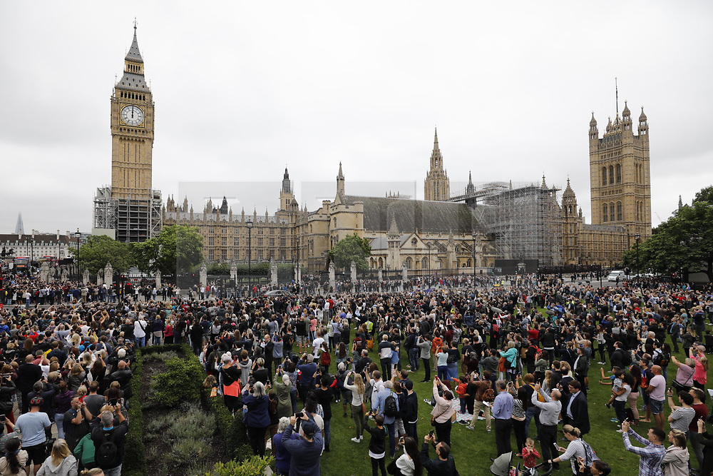 © Licensed to London News Pictures. 21/08/2017. London, UK. People gather in Parliament Square as Big Ben chimes for the last time before repairs start. The Great Bell, also known as Big Ben, is expected to be silent for up to four years as renovation work is carried out on Elizabeth Clock Tower. The worlds most famous clock has sounded on the hour for 157 years and last fell silent for maintenance work in 2007. Photo credit: Peter Macdiarmid/LNP