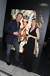 Photographer HUGO BURNAND and curator SUSANNA BROWN at a private view of Photographs by Cecil Beaton celebrating the diamond jubilee of HM The Queen Elizabeth 11 at the Victoria & Albert Museum, Cromwell Road, London on 6th February 2012.