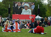 © Licensed to London News Pictures. 05/06/2012. London, UK. People watch the Service of Thanksgiving in St James Park London ad on the Mall on large public screens. .  The Royal Jubilee celebrations. Great Britain is celebrating the 60th  anniversary of the countries Monarch HRH Queen Elizabeth II accession to the throne this weekend Photo credit : Stephen Simpson/LNP