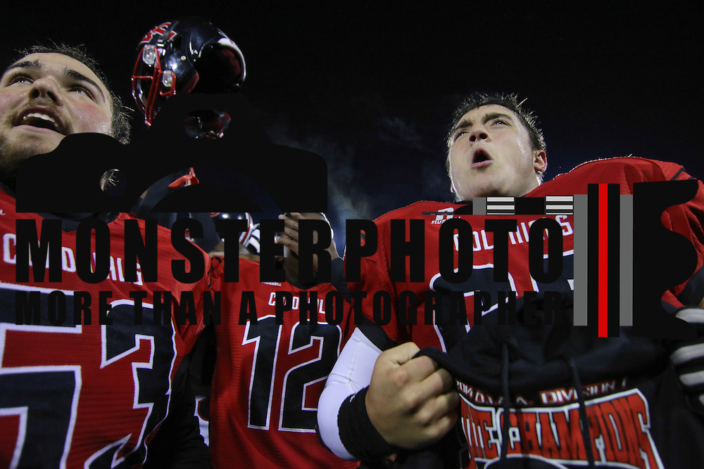 William Penn defensive tackle Brandon Dooley (66), RIGHT, and his teammates celebrates DIAA State Championship after William Penn defeated Middletown 42-14 Saturday, Nov. 29 2014, at Delaware Stadium in Newark Delaware.