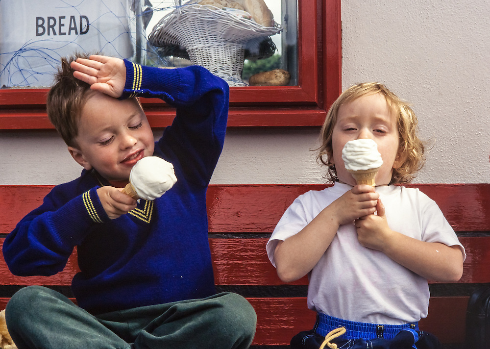 toddlers enjoying eating their ice-cream cones