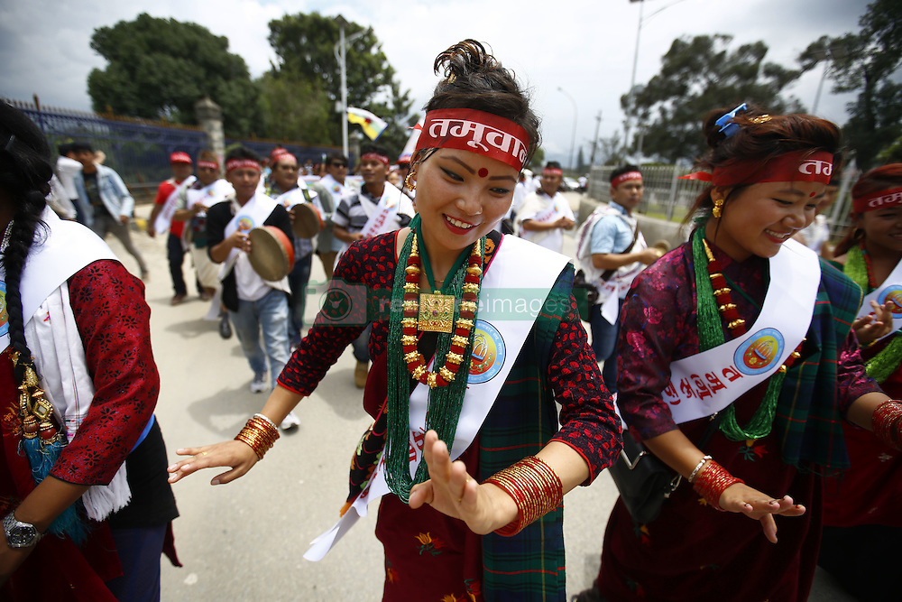 August 9, 2016 - Kathmandu, Nepal - Nepalese women from various ethnic groups perform a traditional dance while taking part in a rally to mark International Day of the World's Indigenous Peoples in Kathmandu, Nepal on Tuesday, August 9, 2016. This day is celebrated worldwide to promote and protect the rights of the world's indigenous population. (Credit Image: © Skanda Gautam via ZUMA Wire)