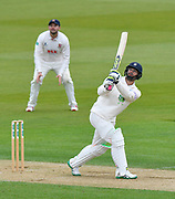 Six - Rilee Rossouw of Hampshire hits the ball over the boundary for six runs during the first day of the Specsavers County Champ Div 1 match between Hampshire County Cricket Club and Essex County Cricket Club at the Ageas Bowl, Southampton, United Kingdom on 5 April 2019.