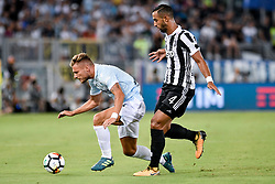 August 13, 2017 - Rome, Italy - Ciro Immobile of Lazio is challenged by Mehdi Benatia of Juventus during the Italian Supercup Final match between Juventus and Lazio at Stadio Olimpico, Rome, Italy on 13 August 2017. (Credit Image: © Giuseppe Maffia/NurPhoto via ZUMA Press)