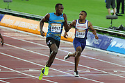 Usain Bolt of Jamaica and Chijindu Ujah of Great Britain in the 100m heat during the Sainsbury's Anniversary Games at the Queen Elizabeth II Olympic Park, London, United Kingdom on 24 July 2015. Photo by Ellie Hoad.