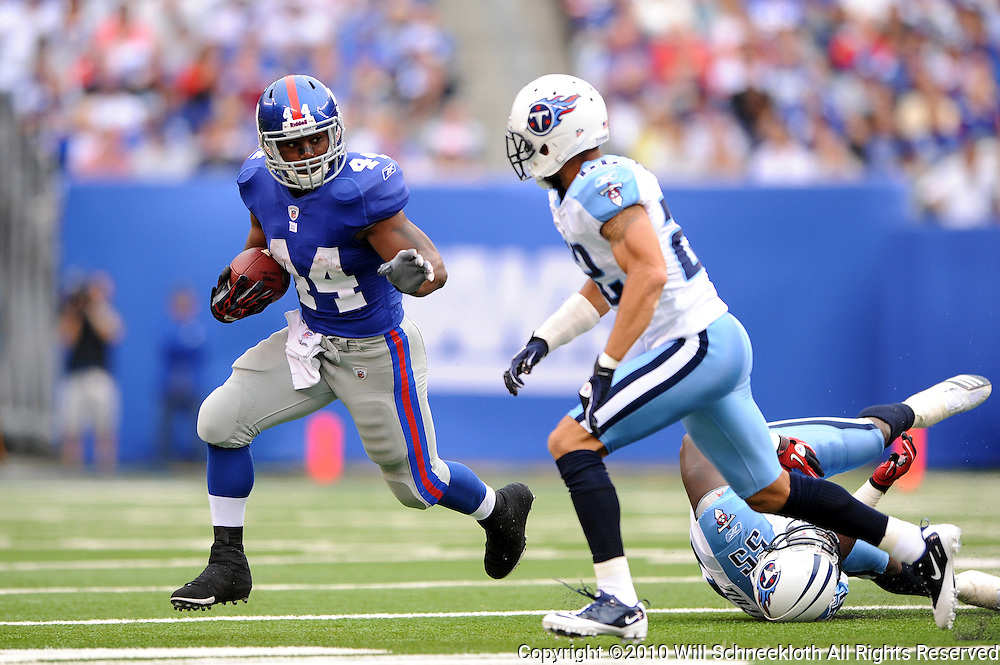 Running back Ahmad Bradshaw #44 of the New York Giants runs during first half NFL football action between the New York Giants and Tennessee Titans at New Meadowlands Stadium in East Rutherford, New Jersey. The game is tied at half time.