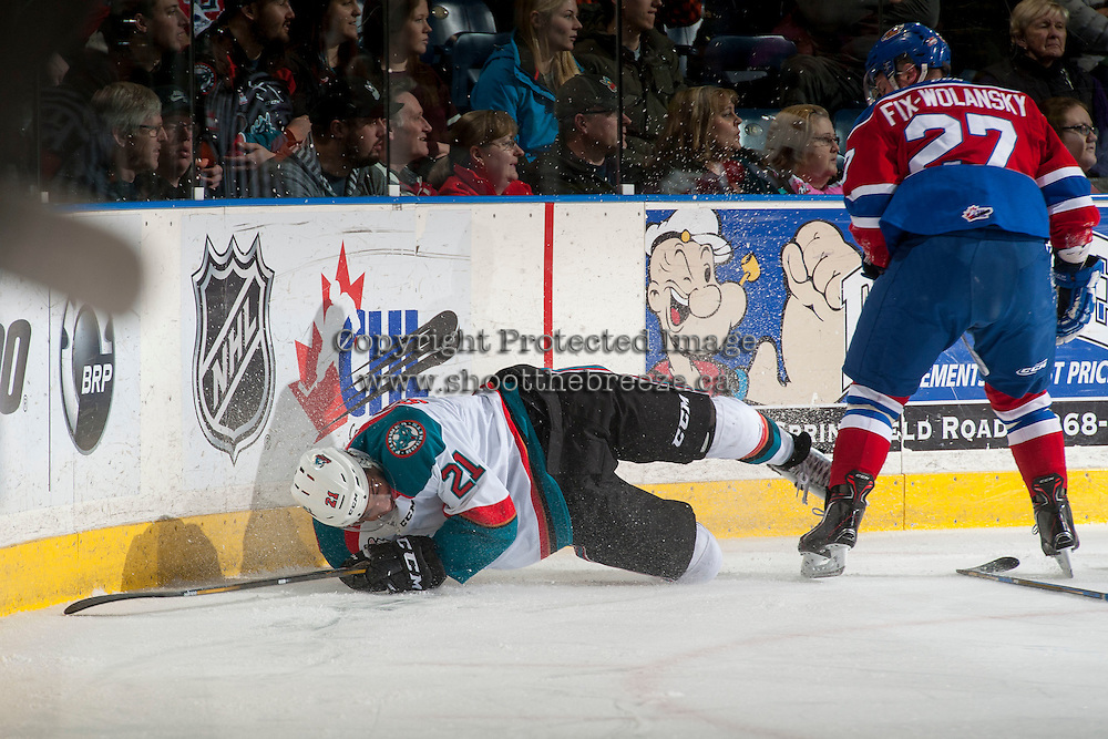 KELOWNA, CANADA - FEBRUARY 22: Trey Fix-Wolansky #27 of the Edmonton Oil Kings checks Devante Stephens #21 of the Kelowna Rockets to the ice during first period on February 22, 2017 at Prospera Place in Kelowna, British Columbia, Canada.  (Photo by Marissa Baecker/Shoot the Breeze)  *** Local Caption ***