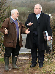 © Licensed to London News Pictures. 26/02/2015. Wells, UK Eric Pickles, Secretary of State for Communities and Local Government with Somerset County Cllr  Harvey Siggs, looking at Green field sites in Wells today 26th February 2015, which may be developed into housing in the future . Photo credit : Jason Bryant/LNP