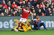 Bailey Wright (5) of Bristol City is tackled by Joao Moutinho (28) of Wolverhampton Wanderers during the The FA Cup 5th round match between Bristol City and Wolverhampton Wanderers at Ashton Gate, Bristol, England on 17 February 2019.