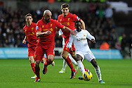 Swansea city's Nathan Dyer goes past  Liverpool's Jose Enrique (l) and Steven Gerrard. Barclays Premier league, Swansea city v Liverpool at the Liberty Stadium in Swansea , South Wales on Sunday 25th November 2012. pic by Andrew Orchard, Andrew Orchard sports photography,
