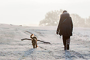 UNITED KINGDOM, London: 22 November 2018 An early morning walker and her dog make their way through a frosty Richmond Park during sunrise this morning. Temperatures sunk to zero degrees in the capital last night. Rick Findler  / Story Picture Agency