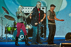 © Licensed to London News Pictures.  30/11/2012. LONDON, UK. Gadget Show presenters Jason Bradbury (pictured right), Pollyanna Woodward (pictured left) and Jon Bentley (pictured centre) host a Christmas themed technology show at the Gadget Show Live event at the ExCel centre in London, The event opened today (Friday 30th) and runs until Sunday. . Photo credit :  Cliff Hide/LNP