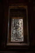 Stone relief faces at Bayon temple.