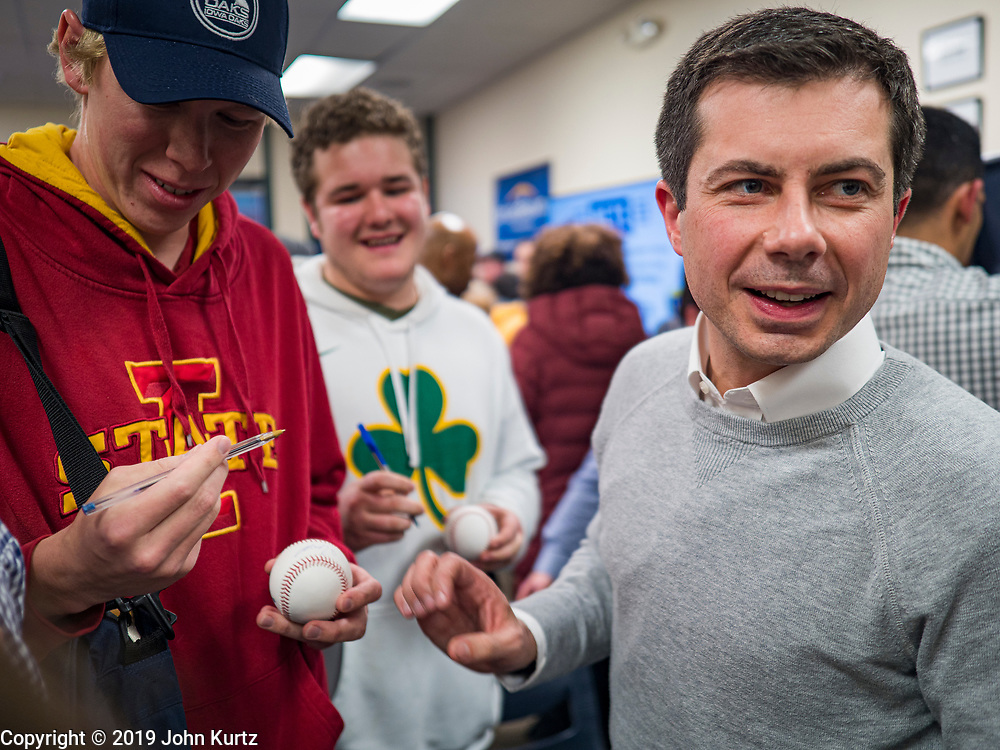 28 DECEMBER 2019 - DES MOINES, IOWA: Mayor PETE BUTTIGIEG, right, signs baseballs during a meet and greet with Buttigieg in Des Moines. Buttigieg talked to a crowd of about 75 people at Urban Dreams, an African-American community empowerment center in Des Moines. It was a part of Buttigieg's continuing outreach to African-American voters. Buttigieg, the mayor of South Bend, Indiana, is running to be the Democratic nominee for President in the 2020 election. Iowa traditionally holds the first presidential selection event of the 2020 election cycle. The Iowa Caucuses are on Feb. 3, 2020.          PHOTO BY JACK KURTZ