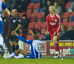 WIGAN, ENGLAND - Monday, March 8, 2010: Liverpool's Fernando Torres can't believe it as he's shown the yellow card against Wigan Athletic during the Premiership match at the DW Stadium. (Photo by David Rawcliffe/Propaganda)