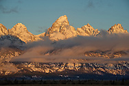 Sunrise bathes the Tetons in golden rays Saturday morning in Grand Teton National Park.