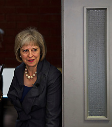 © Licensed to London News Pictures. 23/07/2015. London, UK. British home Secretary THERESA MAY arriving  arriving to deliver a speech on the relationship between police and the community at Brixton Recreation Centre in Brixton, south London.  Photo credit: Ben Cawthra/LNP