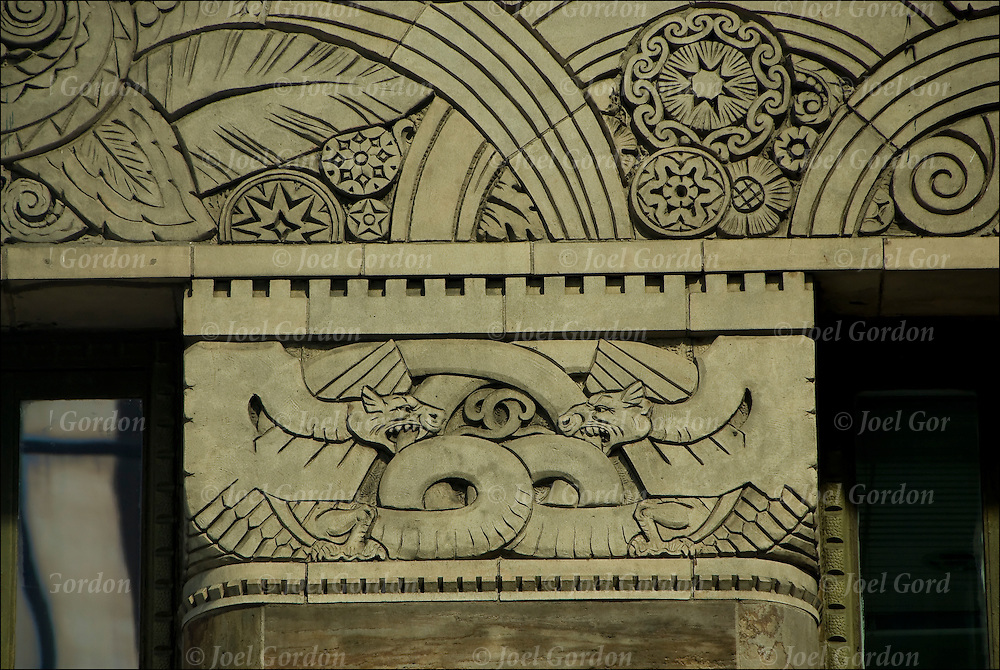 Art Deco reliefs depicting dragons, animals and leaf themes run the whole length of the lower facade of the Chanin Building in New York City.
