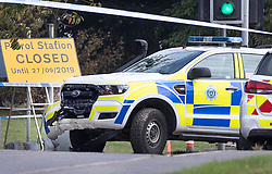 © Licensed to London News Pictures. 23/09/2019. Littlehampton, UK. A damaged police car is seen on the A259 road near Littlehampton where two police officers were hit by a car early this morning. A driver has been arrested on suspicion of attempted murder after three people, two of them police officers, were hit by a moving vehicle in Littlehampton. Photo credit: Peter Macdiarmid/LNP
