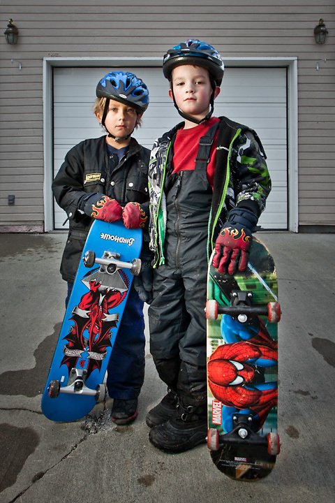 Seven year olds Quinn Carey and Jackson Horton with their skateboards, South Addition, Anchorage