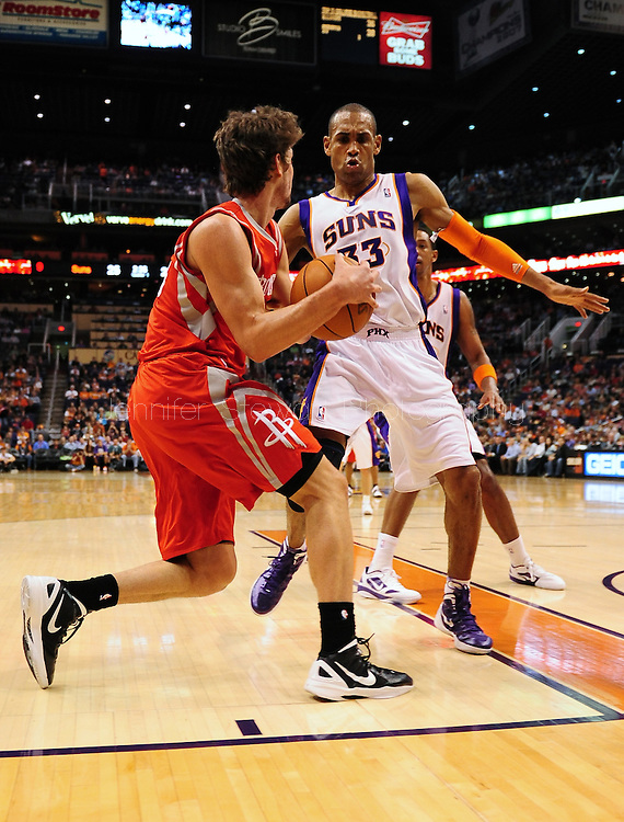 Feb. 9, 2012; Phoenix, AZ, USA; Phoenix Suns forward Grant Hill (33) guards the Houston Rockets guard Courtney Lee (25) during the first half at the US Airways Center. The Rockets defeated the Suns 96-89. Mandatory Credit: Jennifer Stewart-US PRESSWIRE..