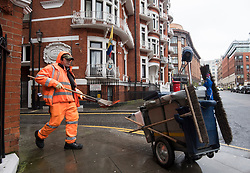 © Licensed to London News Pictures. 13/02/2018. London, UK. A road sweeper outside the Embassy of Ecuador in London before a court ruling on his arrest warrant of WikiLeaks founder Julian Assange. The Australian and Ecuadoran national skipped bail to enter the embassy in 2012 in order to avoid extradition to Sweden over allegations of sexual assault and rape, which he denies. Photo credit: Ben Cawthra/LNP