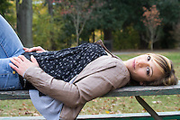 Portrait of a woman laying on a table in the park