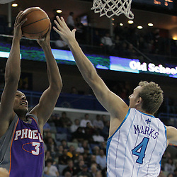 03 December 2008:  Phoenix Suns forward Grant Hill (33) goes up for a shot as New Orleans Hornets forward Sean Marks (4) defends during a 104-91 victory by the New Orleans Hornets over the Phoenix Suns at the New Orleans Arena in New Orleans, LA..