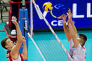 (L) Dmitriy Muserskiy from Russia in action during the 2013 CEV VELUX Volleyball European Championship match between Russia v France at Ergo Arena in Gdansk on September 25, 2013.<br /> <br /> Poland, Gdansk, September 25, 2013<br /> <br /> Picture also available in RAW (NEF) or TIFF format on special request.<br /> <br /> For editorial use only. Any commercial or promotional use requires permission.<br /> <br /> Mandatory credit:<br /> Photo by &copy; Adam Nurkiewicz / Mediasport
