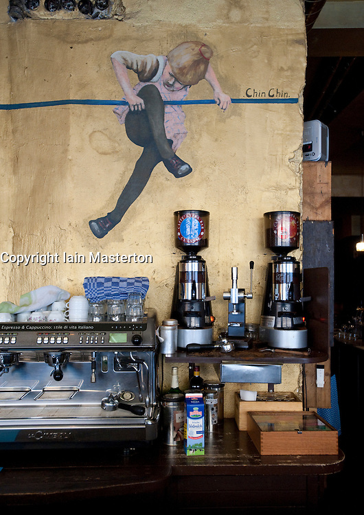 Detail of bar and cafe on Oranienstrasse in bohemian Kreuzberg district of Berlin 2009<br /> Painting on wall is by artist Chin Chin
