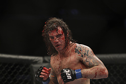 Dec 12, 2009; Memphis, TN, USA; Clay Guida is covered in blood during his bout against Kenny Florian at UFC 107 at the FedEx Forum in Memphis, TN.  Florian won via rear naked choke in the 2nd round.