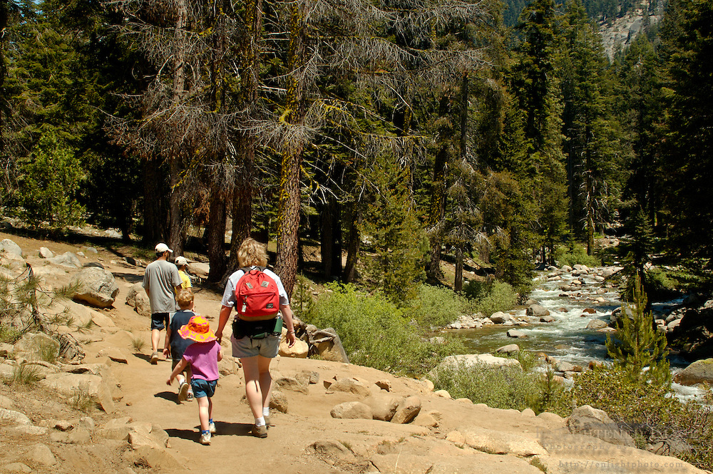 Family hiking along the Kaweah River, Tokopah Falls trail, near Lodgepole, Sequoia National Park, California