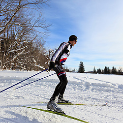 A man cross-country skiing at the Notchview Reservation in Windsor, Massachusetts. The Trustees of Reservations.