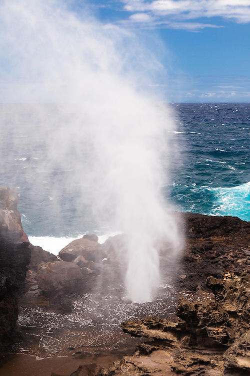 A strong blow at the Nakelele Blowhole on the westside of Maui, Hawai'i from the lava shelf overlook..