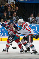 KELOWNA, CANADA - MARCH 22: Rourke Chartier #14 of the Kelowna Rockets stick checks Braden Purtill #29 of the Tri-City Americans off the face off on March 22, 2014 during game 1 of the first round of WHL Playoffs at Prospera Place in Kelowna, British Columbia, Canada.   (Photo by Marissa Baecker/Getty Images)  *** Local Caption *** Rourke Chartier; Braden Purtill;