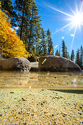 """Secret Cove in Autumn 6"" - Over/under photograph of fall foliage along the shore at Secret Cove, Lake Tahoe."