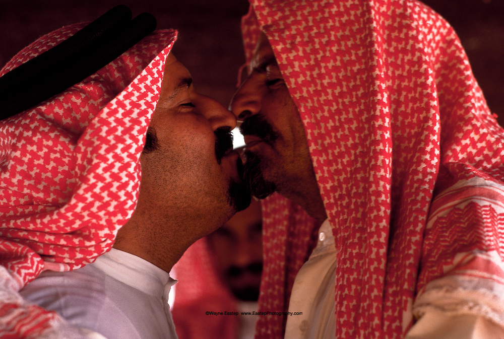 Mohammed Alerq and Nasser Al Amrah of the Al Murrah tribe in a typical greeting between equals. Dahana Sands, Saudi Arabia