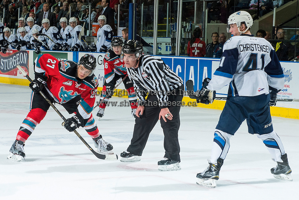 KELOWNA, CANADA - OCTOBER 14: Linesman, Kevin Crowell, stands at the face-off between Calvin Thurkauf #27 of Kelowna Rockets and Logan Christensen #41 of Saskatoon Blades on October 14, 2016 at Prospera Place in Kelowna, British Columbia, Canada.  (Photo by Marissa Baecker/Shoot the Breeze)  *** Local Caption *** Kevin Crowell; Calvin Thurkauf; Logan Christensen;