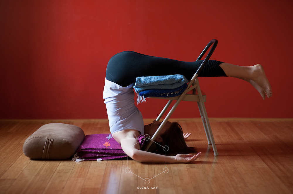 Yoga photography featuring the practice of restorative yoga postures utilizing bolsters, blankets, blocks, and a chair.<br />