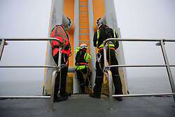 UK ENGLAND NORFOLK SHERINGHAM SHOAL 25SEP13 - Crew member Wayne Gascogne  (L) gets ready to transfer inspection engineers from the bow of the Tidal Transit vessel Tia Elizabeth to a wind turbine at the Sheringham Shoal wind farm in the North Sea off the Norfolk coast, England.<br /> <br /> <br /> <br /> jre/Photo by Jiri Rezac<br /> <br /> <br /> <br /> © Jiri Rezac 2013