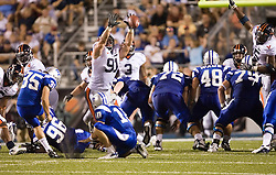 "Virginia defensive end Chris Long (91) blocks a Middle Tennessee State punter Matt King (35) field goal attempt.  The Virginia Cavaliers football team defeated Middle Tennessee State Blue Raiders 23-21 at Johnny ""Red"" Floyd Stadium  in Murfreesboro, TN on October 6, 2007."